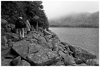 Hikers on shore of Jordan Pond. Acadia National Park ( black and white)