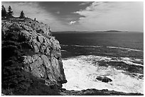Tall granite sea cliff with person standing on top. Acadia National Park ( black and white)