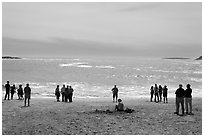 People looking at ocean from Sand Beach. Acadia National Park ( black and white)