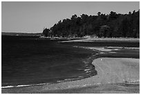 Gravel bar to Bar Harbor Island being submerged by rising tide. Acadia National Park ( black and white)