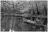 Canoist on Cedar Creek. Congaree National Park ( black and white)