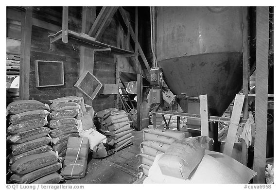 Grain distributor and bags of  seeds in Wilson feed mill. Cuyahoga Valley National Park, Ohio, USA.