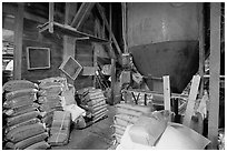 Grain distributor and bags of  seeds in Wilson feed mill. Cuyahoga Valley National Park, Ohio, USA. (black and white)