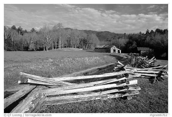 Wooden fence, pasture, and cabin, late afternoon, Cades Cove, Tennessee. Great Smoky Mountains National Park, USA.