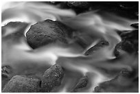 River flow and boulders covered with moss, Tennessee. Great Smoky Mountains National Park, USA. (black and white)