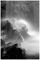Misty water falling on dark rocks, Grotto falls, Tennessee. Great Smoky Mountains National Park, USA. (black and white)
