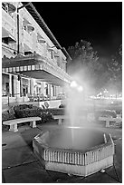 Fountain with thermal steam outside Fordyce Bath at night. Hot Springs National Park ( black and white)