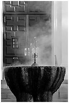 Fountain with thermal steam outside Park Visitor Center. Hot Springs National Park ( black and white)