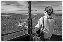 Tourist looking at the view from Hot Springs Mountain Tower in the fall. Hot Springs National Park ( black and white)