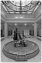 Statue of Desoto receiving gift from Caddo Indian maiden in mens bath hall. Hot Springs National Park ( black and white)