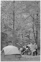 Tent and motorcycle camper under trees in fall colors. Hot Springs National Park ( black and white)