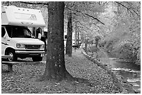 RV, trees in fall colors, and stream. Hot Springs National Park ( black and white)