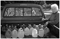 Resident stocks up on natural spring water. Hot Springs National Park ( black and white)