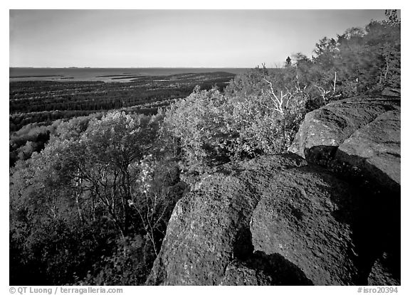 Mount Franklin outcrop, trees, and Lake Superior in the distance. Isle Royale National Park (black and white)
