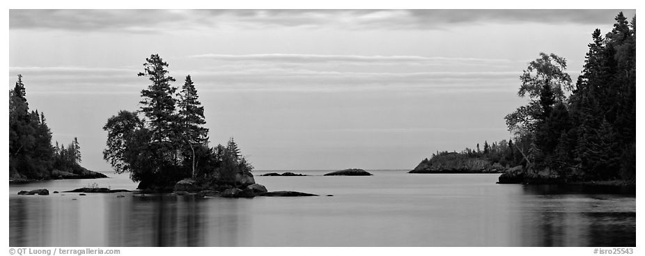 Tree-covered islet at dawn. Isle Royale National Park (black and white)