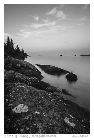 Lichen-colored rocks on Rock Harbor shore, sunset. Isle Royale National Park (black and white)