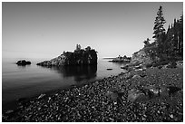Rocky beach, offshore islet, and Lake Superior, Mott Island. Isle Royale National Park ( black and white)