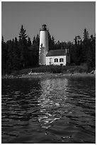 Rock Harbor Lighthouse with tree shadaow and reflection. Isle Royale National Park ( black and white)