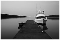 Dock with motorboat and yacht at dusk, Moskey Basin. Isle Royale National Park ( black and white)