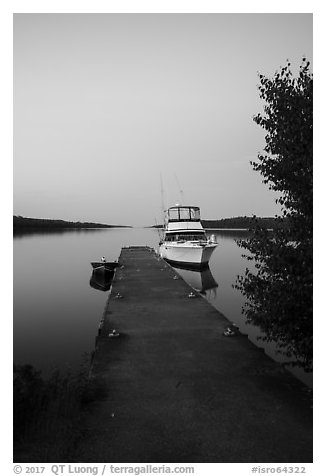 Motorboat and yacht moored at Moskey Basin dock. Isle Royale National Park (black and white)