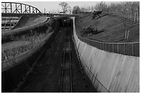Curved south railroad walls and tunnel. Gateway Arch National Park ( black and white)