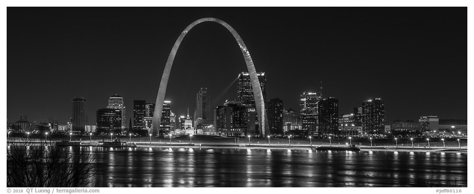 St Louis skyline across Mississippi River at night. Gateway Arch National Park (black and white)
