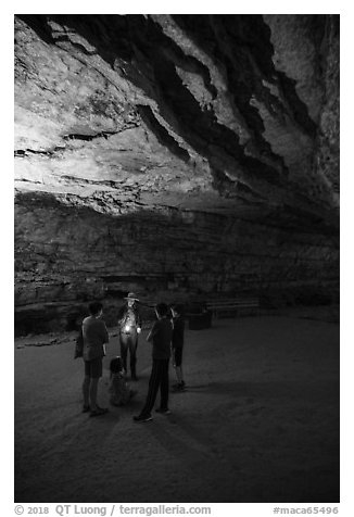 Ranger with lantern talks to family in cave. Mammoth Cave National Park (black and white)