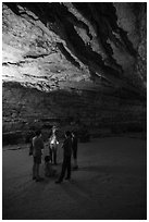 Ranger with lantern talks to family in cave. Mammoth Cave National Park ( black and white)