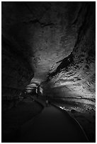 Visitors walk down path in cave. Mammoth Cave National Park ( black and white)