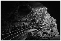 Many visitors waking into cave through historic entrance. Mammoth Cave National Park ( black and white)