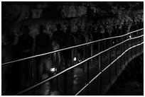 Motion blurred visitors holding lanterns. Mammoth Cave National Park ( black and white)