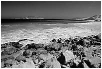 Surf foam and rocks, Cuyler Harbor, mid-day, San Miguel Island. Channel Islands National Park ( black and white)