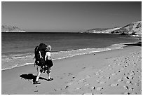 Backpacker on beach, Cuyler harbor, San Miguel Island. Channel Islands National Park ( black and white)