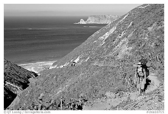 Backpacker going up Nidever canyon trail, San Miguel Island. Channel Islands National Park (black and white)