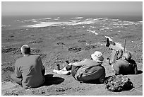 Hikers observing Point Bennett from a distance, San Miguel Island. Channel Islands National Park ( black and white)