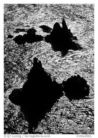 Backlit rocks and water, Cathedral Cove, Anacapa, late afternoon. Channel Islands National Park, California, USA.