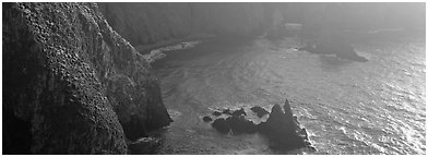 Steep cove with glittering water, Anacapa Island. Channel Islands National Park (Panoramic black and white)