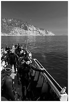 Divers in full wetsuits on diving boat, Santa Cruz Island. Channel Islands National Park ( black and white)