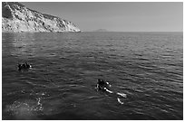 Scuba divers on ocean surface, Santa Cruz Island. Channel Islands National Park ( black and white)