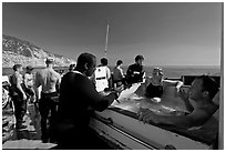 Divers in hot tub aboard the Spectre dive boat, Santa Cruz Island. Channel Islands National Park ( black and white)