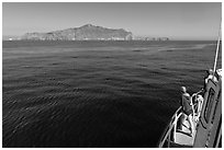 Woman on boat cruising towards Annacapa Island. Channel Islands National Park ( black and white)