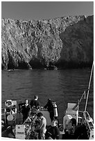 Dive boat and cliffs, Annacapa Island. Channel Islands National Park ( black and white)