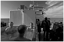 Soaking in hot tub on diving boat, Annacapa Island. Channel Islands National Park ( black and white)