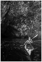 Kayaker near sea cave entrance, Santa Cruz Island. Channel Islands National Park ( black and white)