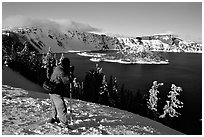 Photographer on  rim of  Lake in winter. Crater Lake National Park ( black and white)
