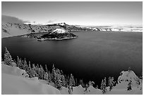 Wizard Island and lake in late afternoon shade, winter. Crater Lake National Park ( black and white)