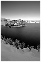 Wizard Island and lake in winter, late afternoon. Crater Lake National Park ( black and white)