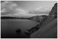 Phantom ship and lake seen from Sun Notch, sunset. Crater Lake National Park, Oregon, USA. (black and white)