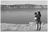 Woman and baby looking at Crater Lake. Crater Lake National Park ( black and white)