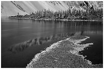 Lava rocks and reflections in Fumarole Bay, Wizard Island. Crater Lake National Park ( black and white)